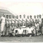 54 State Championship Track team with Coach Wally Bullington on the right and Coach Bob Grosclose on the left.